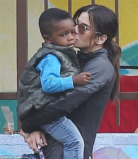 sandra bullock son sandra bullock gives son louis a tender kiss before