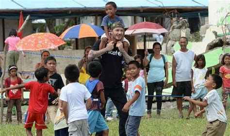 celebrity news 2014 philippines typhoon popular news 101 david beckham enjoys a game of footie with typhoon haiyan
