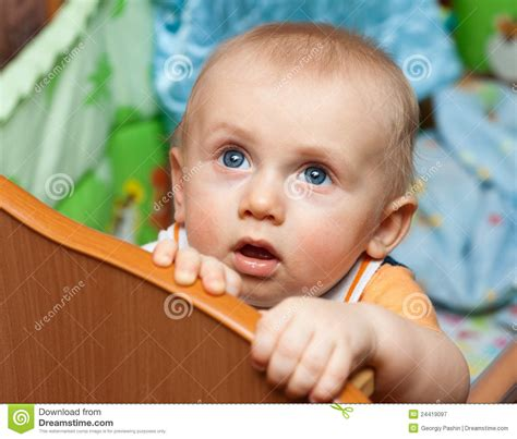 baby standing in crib baby standing in crib royalty free stock photography