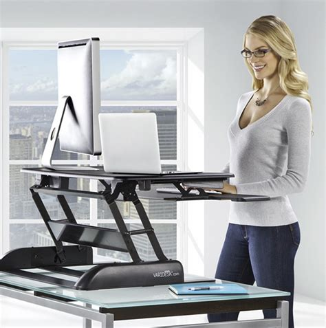 standing up desks to work at convert your existing desk to a standing desk with varidesk