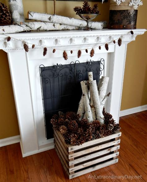 decorating the mantel for winter with book page snowflakes