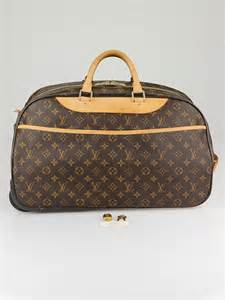 louis vuitton monogram canvas eole  rolling duffle bag