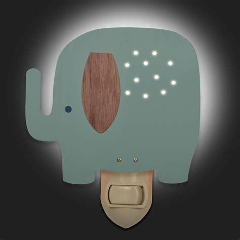 blue elephant light by tree by kerri