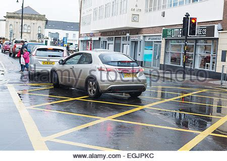cars in a yellow box junction in cardiff, uk. cameras have
