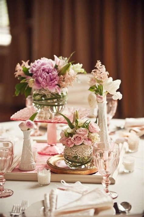 centerpieces ideas for tables lace wrapped glass vases unique centerpiece ideas unique