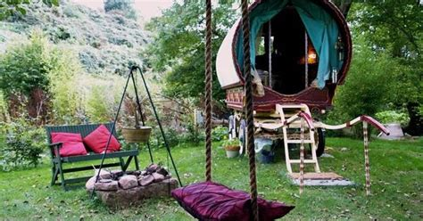 swing wizard gypsy caravan in the backyard complete with swing and