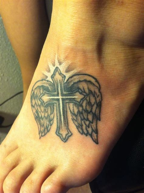 tattoos of crosses with angel wings cross with wings i will this one day