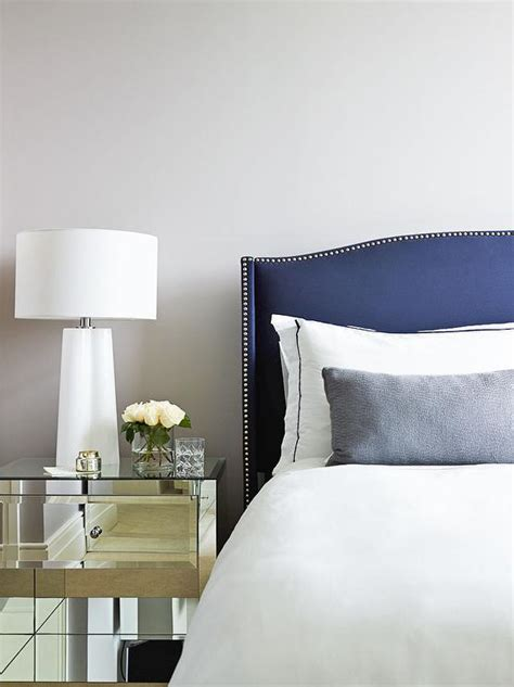 navy velvet curved headboard with nailhead trim and