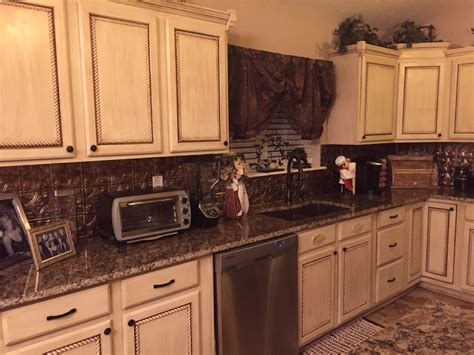 used kitchen cabinet doors we used trim on the cabinet doors back splash panels