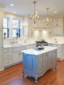 Traditional white kitchen with distressed island hgtv