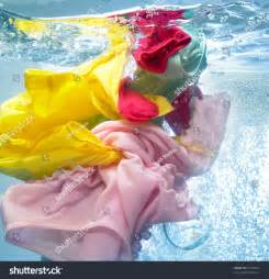 What Color Clothes Can Be Washed Together - colorful clothes washing machine stock photo 93305026 shutterstock