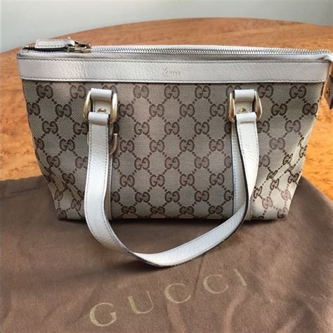 Gucci Tote Ring Kanvas 57 Gucci Handbags Gucci Ivory Gg Canvas D