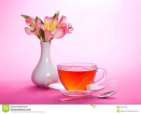 cup of tea and sugar teaspoon vase stock photo image