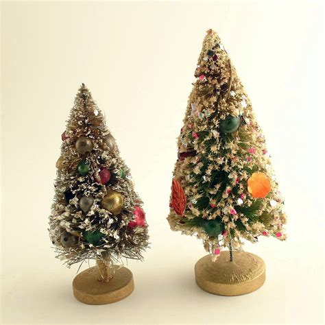 two vintage decorated christmas bottle brush trees