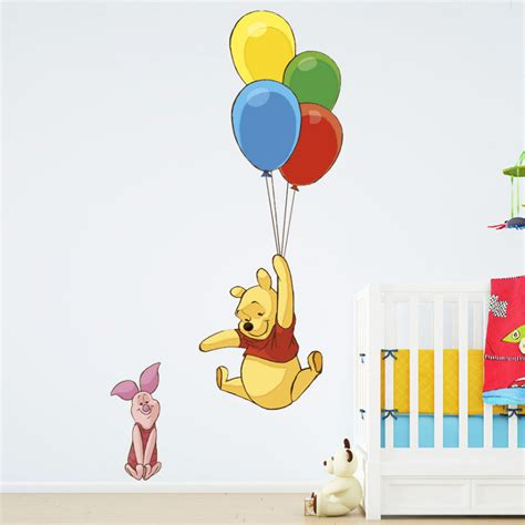 winnie the pooh wall sticker winnie the pooh flying balloons wallsticker fra kun