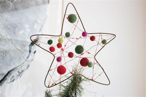 how to make a wire hanger christmas tree how to make a tree topper using an upcycled wire hanger diy