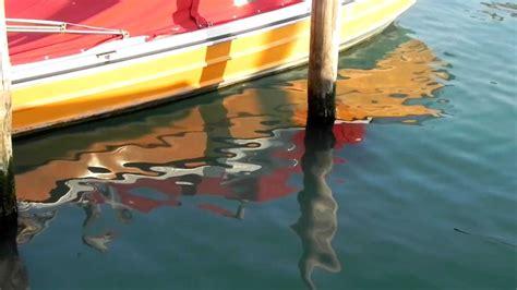 water in boat motor venice water reflections motor boat