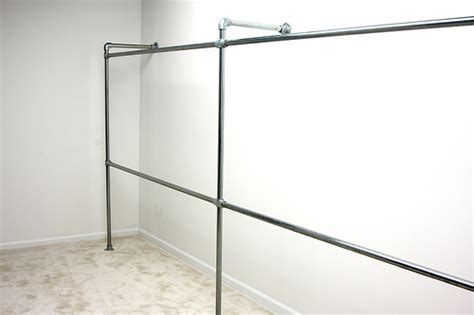 Wall Clothes Rack by Wall Mounted Clothing Rack
