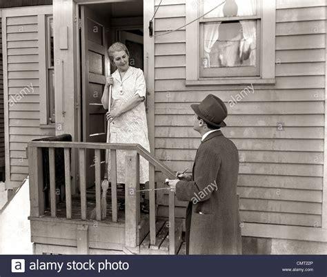 Door Salesman by 1940s 1930s Door To Door Salesman Talking To At Stock Photo Royalty Free