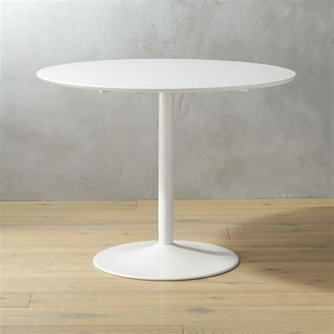White Table by Odyssey White Tulip Dining Table Cb2