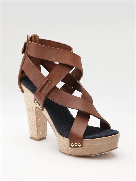 strappy brown sandals givenchy criss cross strappy clog sandals in brown lyst