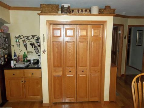 Large Cabinet Pantry Large Pantry Cabinet With Brown Wooden Doors On White