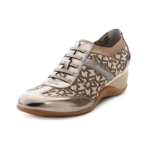 dkny shoes dkny piri wedge sneakers in brown chino logo lyst