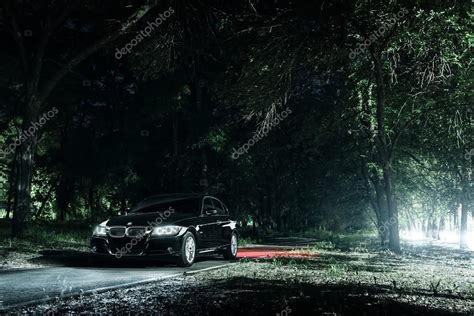 road in forest stock photo image of darkness mist black car bmw e90 stand on road in darkness forest at