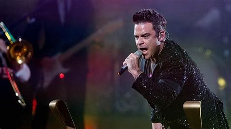 Pop Nosh Robbie Williams Does Rehab by Robbie Williams Fears Miley Cyrus Is Bound For Rehab