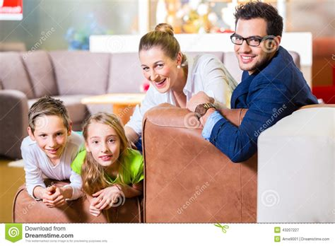 Family Couches by Family Buying In Furniture Store Stock Image Image