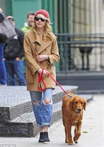 emma stone dog emma stone covers up in over sized coat as she takes her