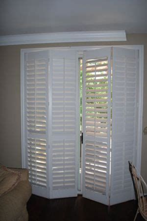 Wooden Shutters For Patio Doors by Wood Shutters For Sliding Patio Door Living Rooms And