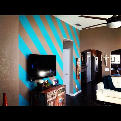 how to paint a room painted diagonal stripes on my living room wall they were
