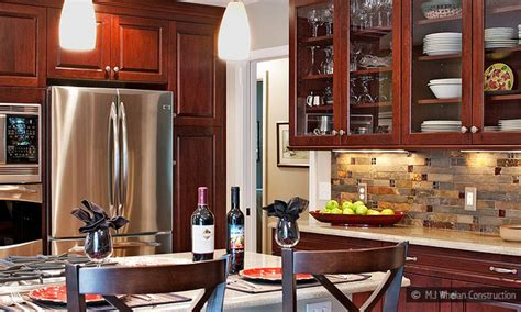 cherry kitchen cabinets with granite countertops subway