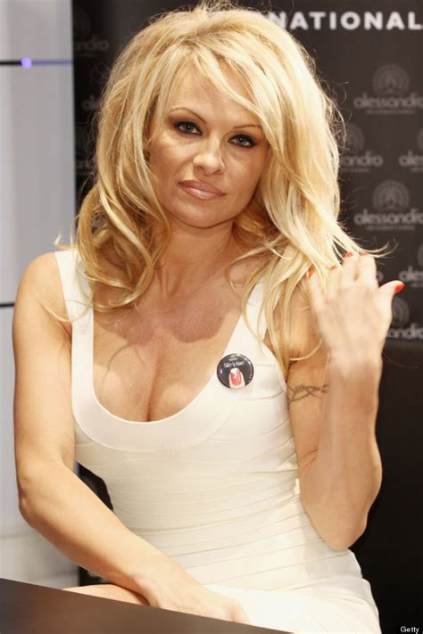 pamela anderson cuts her long hair into platinum pixie do