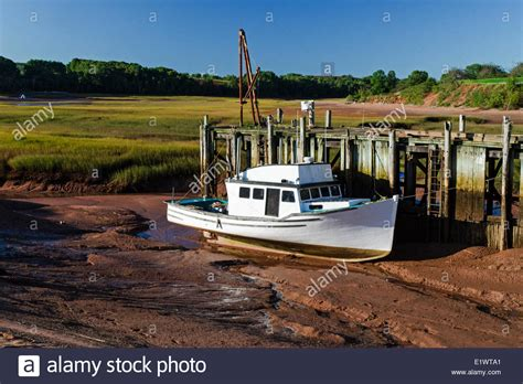 low tide flats boats for sale fishing boat stranded on the mud flats at low tide in