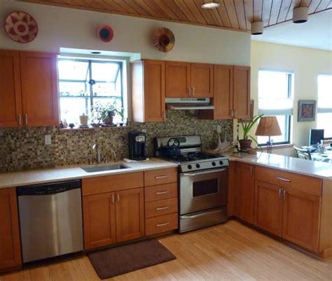 maple cabinets earth toned glass tile backsplash and