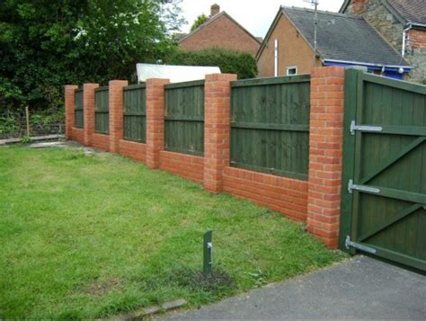here s a backyard brick and wood privacy fence new