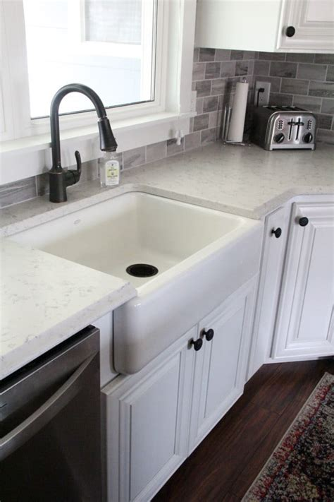install farmhouse sink existing counter installing a kohler whitehaven sink bright green door