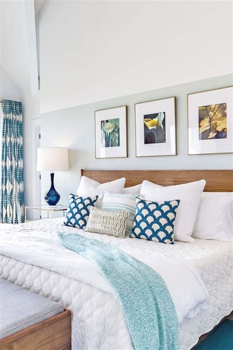 teal accents bedroom beach house bedroom with teal accents half wall is