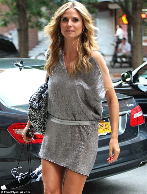 heidi klum shows off amazingly toned legs in mini dress in