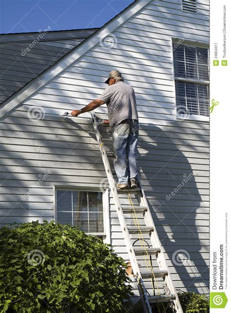 looking for a man who paints houses man painting house senior stock image image 24854317