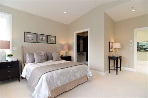 neutral colors for bedroom pink beige carpet and headboard skirt green beige walls taupe accent pillows and coverlet and