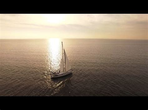 sailing boat in the sea aerial drone shot of a sailing boat in the sea stock