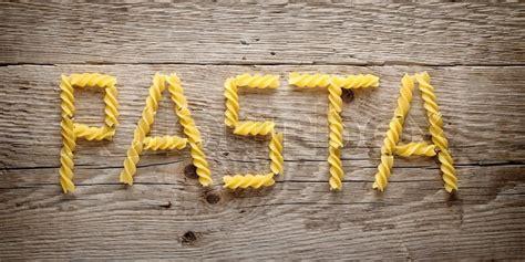 word pasta   fusilli   wooden background