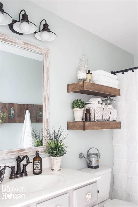 modern farmhouse bathroom with rustic wood shelving above