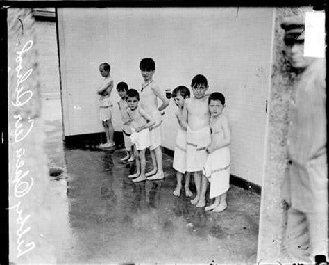 ecc boys from libby school showering in the sherman
