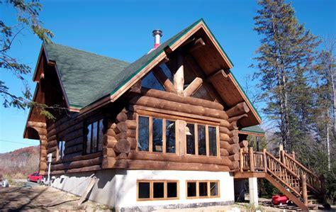 maison en bois rond construction charicconstruction charic