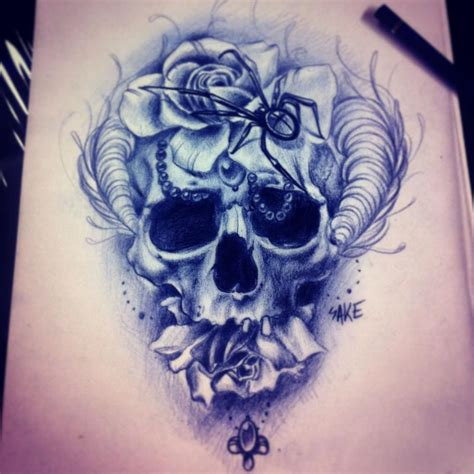 skull with flowers tattoo sake artist the vandallist