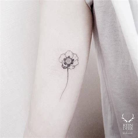 flower small tattoo 15 of the smallest most flower tattoos small